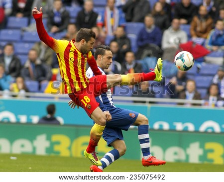 BARCELONA - MARCH, 29: Jordi Alba of FC Barcelona in action during a Spanish League match against RCD Espanyol at the Estadi Cornella on March 29, 2014 in Barcelona, Spain - stock photo