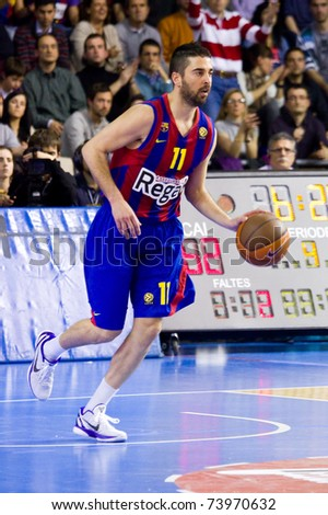BARCELONA - MARCH 24: Juan Carlos Navarro in action during the Euroleague basketball match between Barcelona and Panathinaikos, 71-75, on March 24, 2011 in Palau Blaugrana stadium in Barcelona, Spain. - stock photo