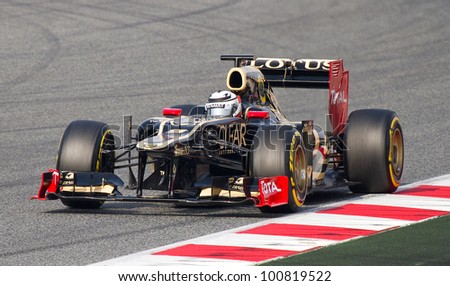 BARCELONA - MARCH 4: Kimi Raikkonen of Lotus Renault F1 team races during Formula One Teams Test Days at Catalunya circuit on March 4, 2012 in Barcelona, Spain. - stock photo