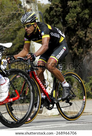 BARCELONA - MARCH, 29: Leonardo Luque of Colombia Team rides during the Tour of Catalonia cycling race through the streets of Monjuich mountain in Barcelona on March 29, 2015 - stock photo