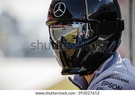 BARCELONA - MARCH 1: Lewis Hamilton of Mercedes AMG F1 Team reflected in the googles of team's mechanic at Formula One Test Days at Catalunya circuit on March 1, 2016 in Barcelona, Spain. - stock photo