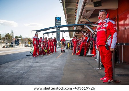 BARCELONA - MARCH 3: Mechanics of Ferrari F1 Team prepared for pit stop at Formula One Test Days at Catalunya circuit on March 3, 2016 in Barcelona, Spain. - stock photo