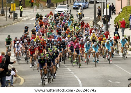 BARCELONA - MARCH, 29: Pack of the cyclists ride during the Tour of Catalonia cycling race through the streets of Monjuich mountain in Barcelona on March 29, 2015 - stock photo