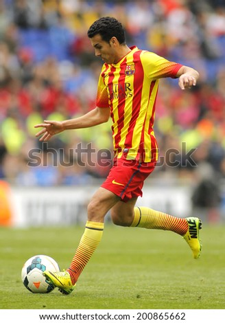 BARCELONA - MARCH, 29: Pedro Rodriguez Ledesma of FC Barcelona in action during a Spanish League match against RCD Espanyol at the Estadi Cornella on March 29, 2014 in Barcelona, Spain - stock photo