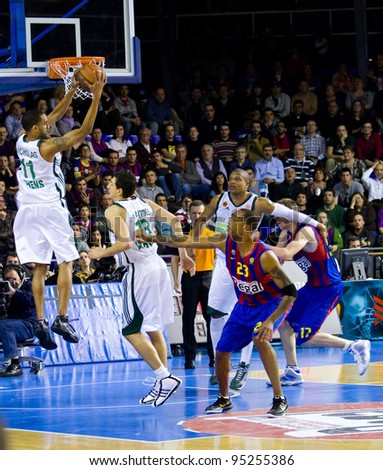 BARCELONA - MARCH 24: Some unidentified players in action during the Euroleague basketball match between FC Barcelona and Panathinaikos, final score 71-75, on March 24, 2011 in Barcelona, Spain. - stock photo