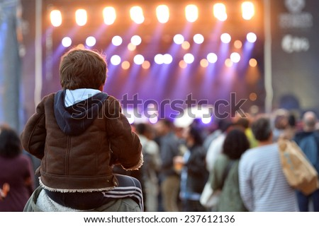 BARCELONA - MAY 28: A kid sitting on the shoulders of his father at Heineken Primavera Sound 2014 Festival (PS14) on May 28, 2014 in Barcelona, Spain. - stock photo
