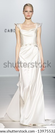 BARCELONA - MAY 03: A model walks on the Cabotine catwalk during the Barcelona Bridal Week runway on May 03, 2013 in Barcelona, Spain. - stock photo