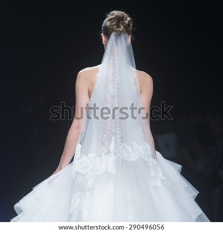 BARCELONA - MAY 07: a model walks on the Cymbeline bridal collection 2016 catwalk during the Barcelona Bridal Week runway on May 07, 2015 in Barcelona, Spain.  - stock photo