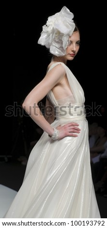 BARCELONA - MAY 13: A model walks on the Cymbeline catwalk during the Barcelona Bridal Week runway on May 13, 2011 in Barcelona, Spain.