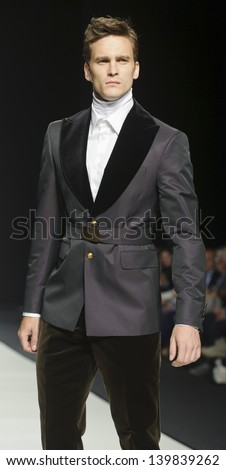 BARCELONA - MAY 03: A model walks on the Fuentecapala catwalk during the Barcelona Bridal Week runway on May 03, 2013 in Barcelona, Spain.