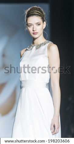 BARCELONA - MAY 07: a model walks on the Jesus Peiro bridal collection 2015 catwalk during the Barcelona Bridal Week runway on May 07, 2014 in Barcelona, Spain.  - stock photo