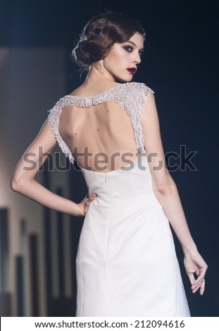 BARCELONA - MAY 09: a model walks on the Miquel Suay bridal collection 2015 catwalk during the Barcelona Bridal Week runway on May 09, 2014 in Barcelona, Spain.  - stock photo