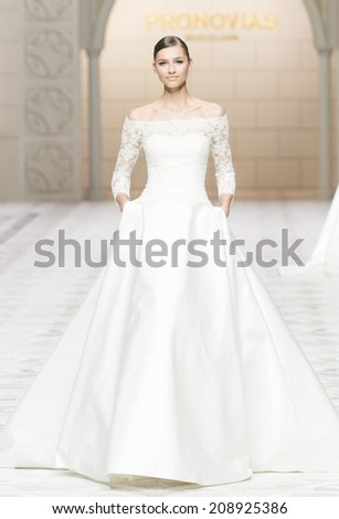 BARCELONA - MAY 09: a model walks on the Pronovias bridal collection 2015 catwalk during the Barcelona Bridal Week runway on May 09, 2014 in Barcelona, Spain.  - stock photo