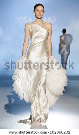 BARCELONA - MAY 08: A model walks on the Rosa Clara catwalk during the Barcelona Bridal Week runway on May 08, 2012 in Barcelona, Spain.