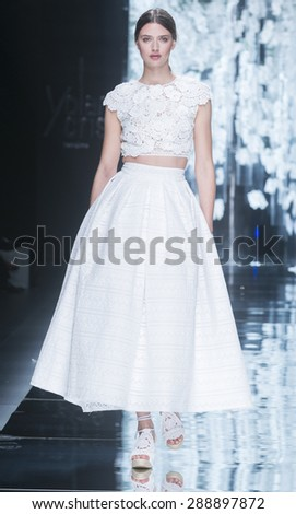 BARCELONA - MAY 06: a model walks on the Yolancris bridal collection 2016 catwalk during the Barcelona Bridal Week runway on May 06, 2015 in Barcelona, Spain.  - stock photo