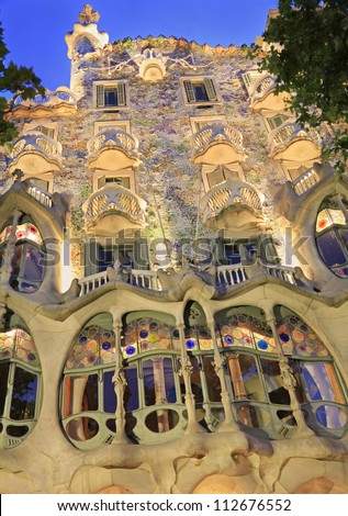 BARCELONA-MAY 30: Casa Batllo at dusk, Barcelona, Spain.Casa Batllo is a key feature in the architecture of modernist Barcelona and was built by Antoni Gaudi between 1904-1906, shot on May 30, 2012. - stock photo
