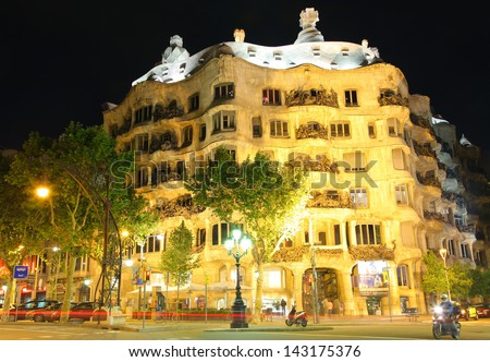 BARCELONA - MAY 7 : Casa Mila or La Pedrera on May 7, 2013 in Barcelona, Spain. This famous building was designed by Antoni Gaudi and is one of the most visited of the city. - stock photo