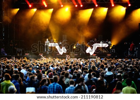 BARCELONA - MAY 30: Crowd (fans) watching a concert at Heineken Primavera Sound 2014 Festival (PS14) on May 30, 2014 in Barcelona, Spain. - stock photo