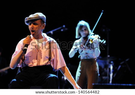 BARCELONA - MAY 25: Dexys band, performs at Heineken Primavera Sound 2013 Festival on May 25, 2013 in Barcelona, Spain. Originally called Dexys Midnight Runners. - stock photo