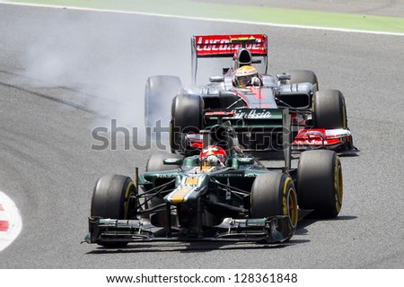 BARCELONA - MAY 13: F1 cars racing at the Formula One Spanish Grand Prix at Catalunya circuit, on May 13, 2012 in Barcelona, Spain. The winner was Pastor Maldonado.