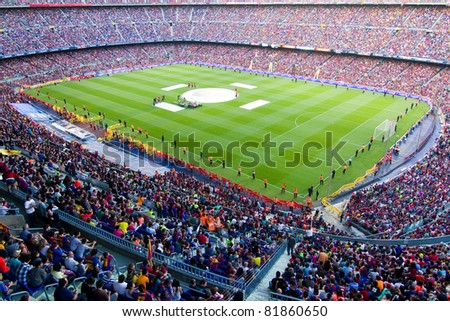 BARCELONA - MAY 29: FC Barcelona players and supporters celebrate the European Champions League and Spanish League trophies, on May 29, 2011 in Camp Nou stadium, Barcelona, Spain. - stock photo