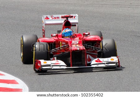 BARCELONA - MAY 12: Fernando Alonso of Ferraro F1 team racing at Qualifying Session of Formula One Spanish Grand Prix at Catalunya circuit, on May 12, 2012 in Barcelona, Spain. - stock photo