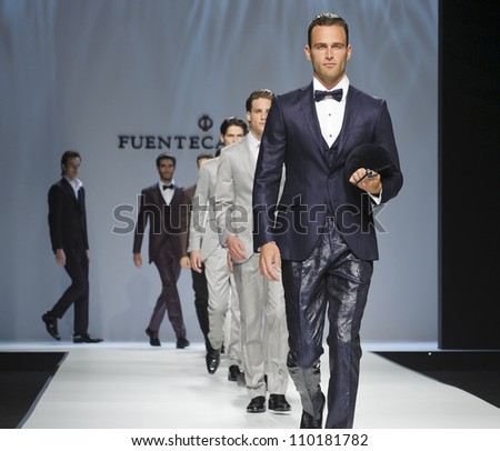 BARCELONA - MAY 11: Models walking on the Fuentecapala catwalk during the Barcelona Bridal Week runway on May 11, 2012 in Barcelona, Spain. - stock photo