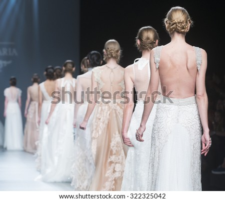 BARCELONA - MAY 07: models walking on the Marcos & Maria bridal collection 2016 catwalk during the Barcelona Bridal Week runway on May 07, 2015 in Barcelona, Spain.  - stock photo