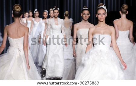 BARCELONA - MAY 13: Models walking on the Pronovias catwalk during the Barcelona Bridal Week runway on May 13, 2011 in Barcelona. - stock photo