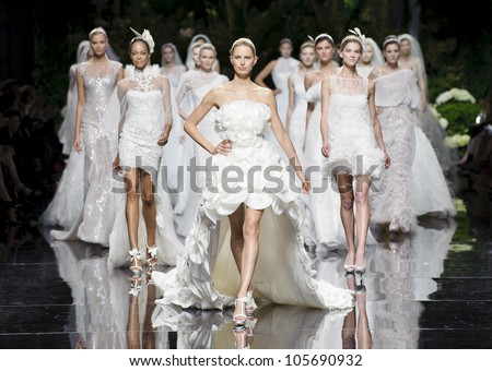 BARCELONA - MAY 11: Models walking with Karolina Kurkova model on the Pronovias catwalk during the Barcelona Bridal Week runway on May 11, 2012 in Barcelona, Spain. - stock photo