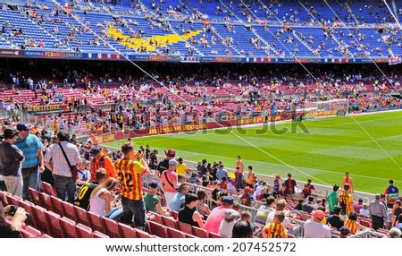 BARCELONA - MAY 03: People at the Camp Nou Stadium prior to the La Liga match between FC Barcelona and Getafe CF on May 3, 2014 in Barcelona, Spain.