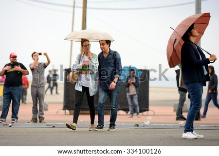 BARCELONA - MAY 28: People with umbrellas at Heineken Primavera Sound 2014 Festival (PS14) on May 28, 2014 in Barcelona, Spain.