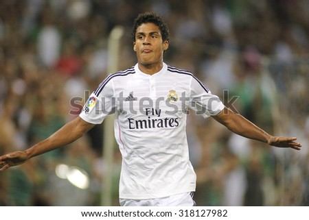 BARCELONA - MAY, 11: Raphael Varane of Real Madrid during the Spanish League match between Espanyol and Real Madrid at the Estadi Cornella on May 11, 2013 in Barcelona, Spain - stock photo