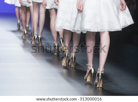 BARCELONA - MAY 06: shoes details of models walking on the Miquel Suay bridal collection 2016 catwalk during the Barcelona Bridal Week runway on May 06, 2015 in Barcelona, Spain.  - stock photo