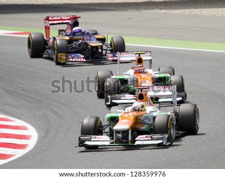 BARCELONA - MAY 13: Some F1 cars racing at the Formula One Spanish Grand Prix at Catalunya circuit, on May 13, 2012 in Barcelona, Spain. The winner was Pastor Maldonado. - stock photo