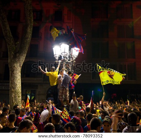 BARCELONA - MAY 11: Some supporters of FC Barcelona celebrate the Spanish League Championship victory in Catalunya square, Canaletes fountain and Rambla street, on May 11, 2011 in Barcelona, Spain.