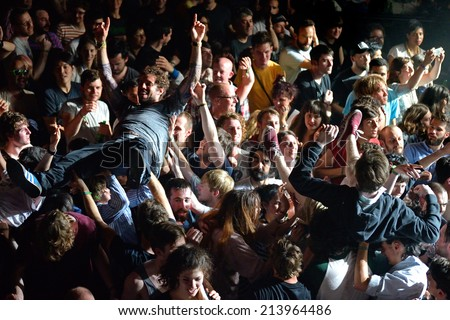BARCELONA - MAY 30: The audience doing crowd surfing (also known as mosh pit) at Heineken Primavera Sound 2014 Festival on May 30, 2014 in Barcelona, Spain. - stock photo