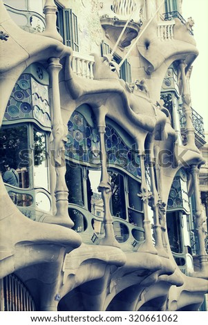BARCELONA - MAY 2, 2015: The facade of the house Casa Battlo (also could the house of bones) designed by Antoni Gaudi with his famous expressionistic style  - stock photo