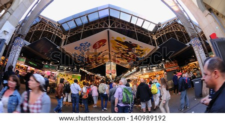 BARCELONA - MAY 13: The Mercat de Sant Josep de la Boqueria on May 13, 2013 in Barcelona, Spain. One of the foremost tourist landmarks, with an entrance from La Rambla and the Liceu (opera house). - stock photo