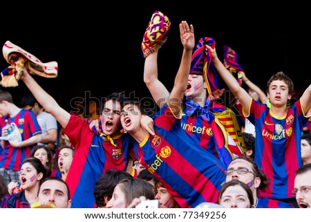 BARCELONA - MAY 13: Unidentified FC Barcelona supporters celebrate the Spanish League Championship victory in Camp Nou stadium, on May 13, 2011 in Barcelona, Spain. - stock photo