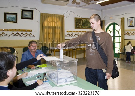 BARCELONA - MAY 25: Unidentified man casts his vote at a polling station during European Parliament Election, on May 25, 2014, in El Masnou, Barcelona, Spain. - stock photo