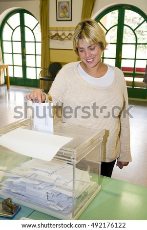 BARCELONA - MAY 25: Unidentified woman casts his vote at a polling station during European Parliament Election, on May 25, 2014, in El Masnou, Barcelona, Spain.