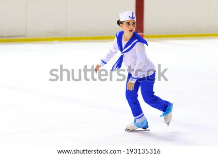 BARCELONA - MAY 03: Young team from a school of skating on ice performs, disguised as sailors, at the International Cup Ciutat de Barcelona Open on May 3, 2014 in Barcelona, Spain.