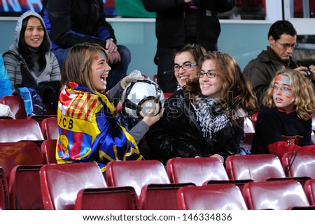 BARCELONA - NOV 10: unidentified Audience return the ball at the Camp Nou Stadium on the Spanish Cup (Copa del Rey) match between F.C Barcelona and Cultural Leonesa on November 10, 2009 in Barcelona, Spain. - stock photo