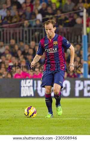 BARCELONA - NOVEMBER 1: Ivan Rakitic of FCB in action at Spanish League match between FC Barcelona and Celta de Vigo, final score 0-1, on November 1, 2014, in Camp Nou stadium, Barcelona, Spain. - stock photo