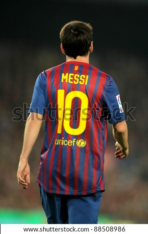 BARCELONA - OCT, 29: Back of Leo Messi of FC Barcelona walks onto the field during the Spanish league match between FC Barcelona and RCD Mallorca at the Nou Camp Stadium on October 29, 2011 in Barcelona, Spain - stock photo