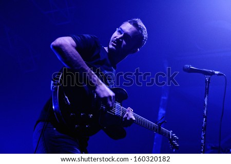 BARCELONA - OCT 19: Tom Smith, lead singer, lyricist, keyboardist and rhythm guitarist for the indie rock band Editors, perfoms at Razzmatazz stage on October 19, 2013 in Barcelona, Spain. - stock photo