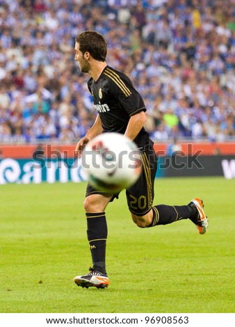 BARCELONA - OCTOBER 2: Gonzalo Higuain in action during the Spanish League match between RCD Espanyol and Real Madrid, final score 0 - 4, on October 2, 2011 in Cornella stadium, Barcelona, Spain.
