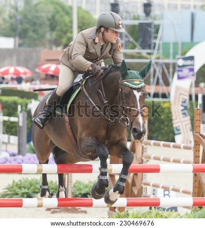 BARCELONA - OCTOBER 10: Simone Coata rider in action during the CSIO El Periodico Trophy in Real Club Polo Barcelona, on October 10, 2014, Barcelona, Spain.