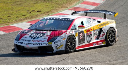 BARCELONA - OCTOBER 30: Unidentified driver racing at Lamborghini Super Trofeo, on October 30, 2011, in Circuit de Catalunya, Barcelona, Spain.
